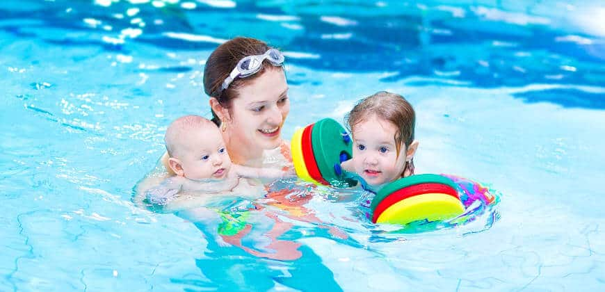 Mother Having Fun in Pool with Children